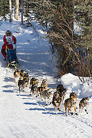 Musher Wattie McDonald on Long Lake at the Re-Start of the 2011 Iditarod Sled Dog Race in Willow, Alaska.