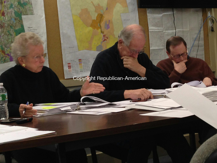 WOODBURY, CT - 21 Jan 2015 - 012115RH01 - (left to right) Deborah Fuller, Chairman William T. Drakeley, and Frank Sherer of the Woodbury Charter Revision Commission prepare a draft with changes to the town's governing document for a public hearing next month. Rick Harrison Republican-American