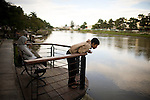 Youth hang out at the new garden park along the Aceh River, in Banda Aceh, Indonesia, on Thursday, Nov. 19, 2009
