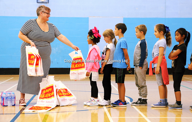 Pictured: Carolyn Harris MP hands out free lunches to children at the Morriston Leisure Centre in Swansea, UK. Friday 25 August 2017<br /> Re: Free food for children story, Swansea, Wales, UK.
