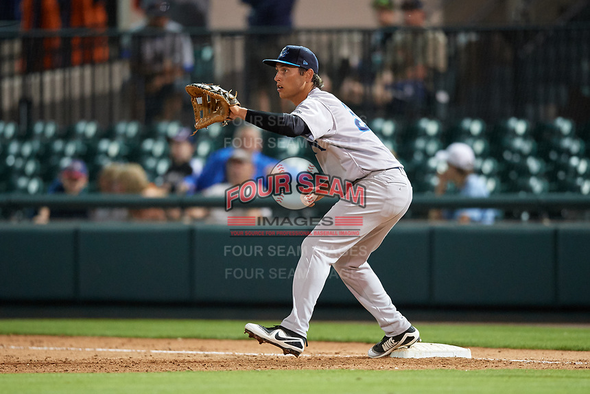 Tampa Tarpons first baseman Brandon Wagner (33) stretches to receive a throw during a game against the Lakeland Flying Tigers on April 5, 2018 at Publix Field at Joker Marchant Stadium in Lakeland, Florida.  Tampa defeated Lakeland 4-2.  (Mike Janes/Four Seam Images)