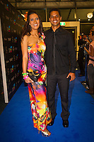 GOLD COAST, Queensland/Australia (Friday, February 24, 2012)  Michel Bourez (PYF) with his wife Viamitihi. The 29th Annual ASP World Surfing Awards went off tonight at the Gold Coast Convention and Exhibition Centre with the worlds best surfers trading the beachwear for formal attire as the 2011 ASP World Champions were officially crowned.. .Kelly Slater (USA), 40, and Carissa Moore (HAW), 19, took top honours for the evening, collecting the ASP World Title and ASP Womens World Title respectively.. .I have actually been on tour longer than some of my fellow competitors have been alive, Slater said. All joking aside, its truly humbling to be up here and honoured in front of such an incredible collection of surfers. I want to thank everyone in the room for pushing me to where I am...In addition to honouring the 2011 ASP World Champions, the ASP World Surfing Awards included new accolades voted on by the fans and the surfers themselves...For the first time in several years, ASP Life Membership was awarded to Hawaiian legend and icon of high-performance surfing, Larry Bertlemann (HAW), 56...Where surfing is today is where I dreamed it should be in the 70s, Bertlemann said. You guys absolutely deserve this and Im so honored to be up here in front of you all tonight..Grammy Award-winning artists Wolfmother and The Vernons rounded out the nights entertainment which was all streamed LIVE around the world on YouTube.com..Photo: joliphotos.com