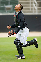 Catcher Miguel Gonzalez #12 of the Kannapolis Intimidators chases after a foul pop fly at Fieldcrest Cannon Stadium April 14, 2010, in Kannapolis, North Carolina.  Photo by Brian Westerholt / Four Seam Images
