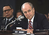 Former United States Secretary of Defense Richard (Dick) Cheney, who is rumored to be Republican Gov. George W. Bush's selection for the Vice Presidential nomination, testifies before the U.S. Senate Armed Services Committee in Washington, DC on the Persian Gulf crisis on 30 November, 1990.  General Colin Powell, Chairman of the Joint Chiefs of Staff, looks on at left.<br /> Credit: Ron Sachs / CNP