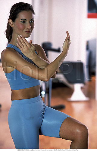 MODEL RELEASED Fitness, Sandrine exercises with aerobics, 0106. Photo: Philippe Millereau/Action Plus...2001.leisure activities.pastime.pastimes.health clubs.health club.fitness.exercise.exercising.lifestyle.work-out.work out.working out.working-out.gym gymnasium.gyms.model released.model release.recreation.female