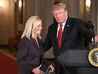United States President Donald J. Trump, right, announces he will name Principal Deputy White House Chief of Staff Kirstjen Nielsen, left, as Secretary of Homeland Security in the East Room of the White House in Washington, DC on Thursday, October 12, 2017.  If confirmed, Nielsen will replace Acting US Secretary of Homeland Security Elaine C. Duke, who has been in that position since General John F. Kelly, USMC (Retired) resigned to become White House Chief of Staff.<br /> Credit: Ron Sachs / CNP /MediaPunch