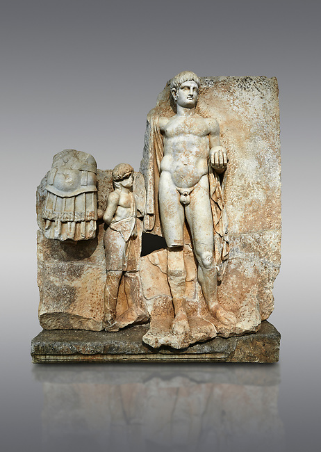 Roman Sebasteion relief  sculpture of Emperor Nero with captive, Aphrodisias Museum, Aphrodisias, Turkey. <br /> <br /> Naked warrior emperor Nero holds the orb of world rule in one hand and crowns the military trophy with the other. Between the trophy and the emperor stands a bound captive boy. He wears long barbarian trousers and looks up at Nero.