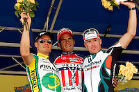 Ford Tour de Georgia Stage 6 winners celebrate on the podium after the stage. From left are third-place Aur&eacute;lien Clerc of Phonak Hearing Systems, first-place Juan Jos&eacute; Haedo of Toyota-United Pro, and second-place Gord Fraser of Health Net Presented by Maxxis. Floyd Landis of Phonak Hearing Systems won the entire Tour de Georgia.<br />