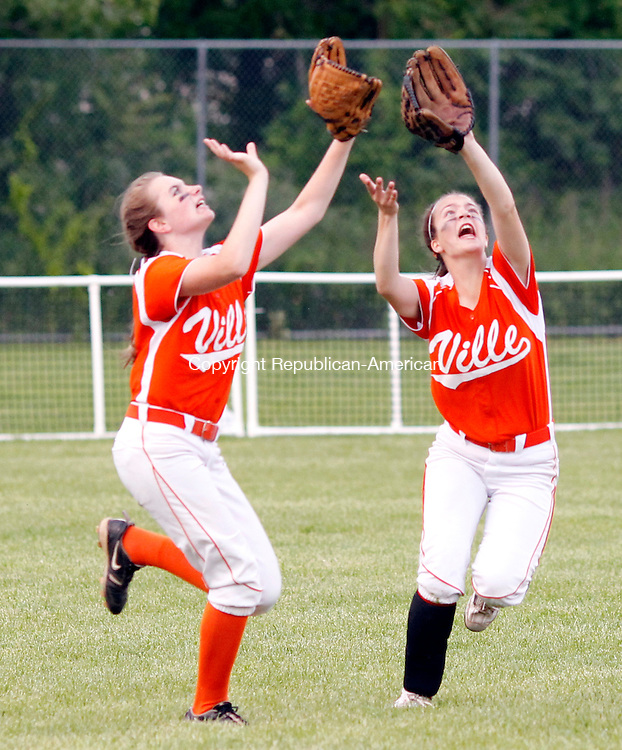 Stratford, CT- 10, June 2011-061011CM09 Terryville's Angel Katiewicz (left) and Brenda Carobini collide after going for a pop fly against Hale Ray, during the Class S softball final at DeLuca Field in Stratford, Friday night. Ville lost, 6-0. Christopher Massa Republican-American