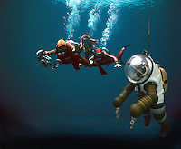 ..Scuba divers with deep sea diver. MR