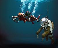 ..Scuba divers with deep sea diver. MR