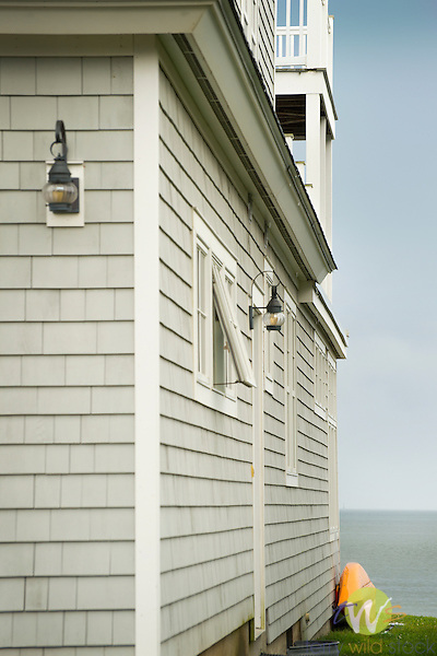 Cottage and kayak facing Long Island Sound.