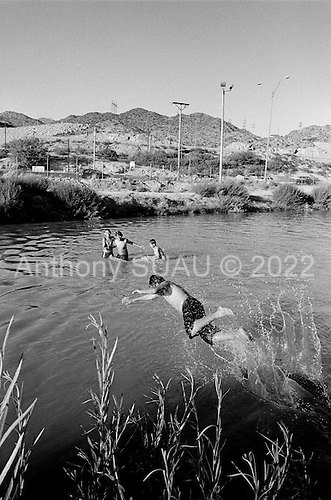 Juarez, Mexico<br /> May 19, 2008<br /> <br /> Mexican children swim in the Rio Grande/rio Bravo river, which is the US/ Mexican - El Paso/Juarez border.