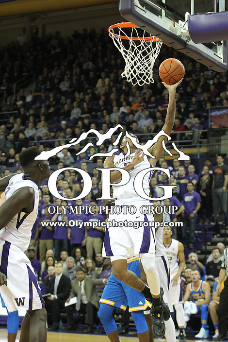 JAN 1, 2016:  Washington's Andrew Andrews drives to the basket against UCLA.  Washington defeated #25 ranked UCLA 96-93 in double overtime at Alaska Airlines Arena in Seattle, WA.