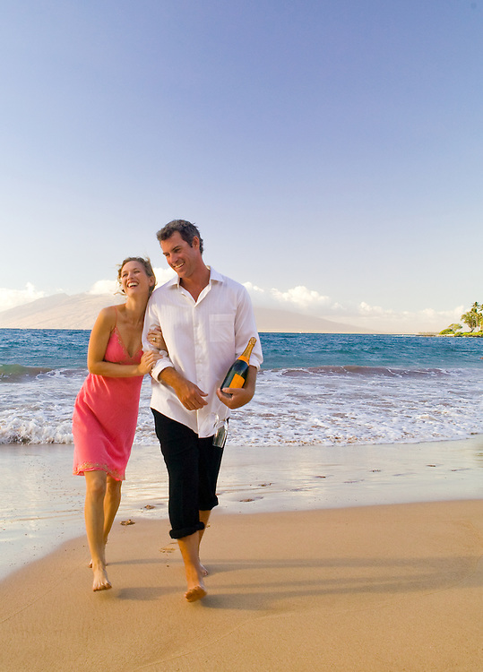 Couple on the beach at the Four Seasons Wialea, Maui, Hawaii
