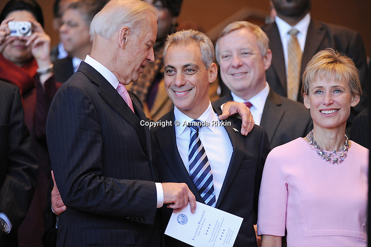 (L-R) Vice-President Joe Biden embraces Chicago Mayor Elect Rahm Emanuel as Emanuel's wife Amy Rule stands beside him and Senator Dick Durbin behind them at the inauguration ceremony for Chicago mayor and other elected public officials in Millennium Park in Chicago, Illinois on May 16, 2011.