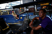 A jeepney and a driver of a rickshaw wait for passengers on a busy intersection in Manila, Philippines. Photo: Sanjit Das