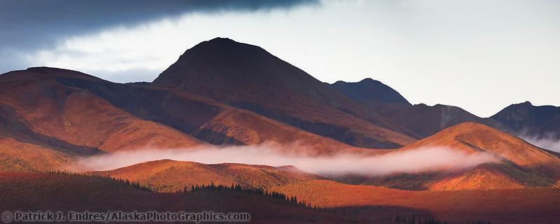 Sunrise and morning fog over the Alaska Range mountains, Denali National Park, Interior, Alaska.