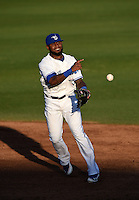 Dunedin Blue Jays shortstop Jose Reyes (7) - on rehab assignment from the Toronto Blue Jays - throws to first for an out during a game against the Daytona Cubs on April 16, 2014 at Florida Auto Exchange Stadium in Dunedin, Florida.  Dunedin defeated Daytona 5-1.  (Mike Janes/Four Seam Images)