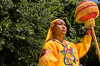 A young man in traditional Asian attire look on during the Charlotte Dragonboat Association racing on Lake Norman in NC.
