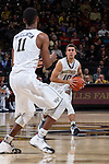 Mitchell Wilbekin (10) of the Wake Forest Demon Deacons looks to pass the ball to teammate Greg McClinton (11) during first half action against the Louisville Cardinals at the LJVM Coliseum on January 4, 2015 in Winston-Salem, North Carolina.  The Cardinals defeated the Demon Deacons 85-76.  (Brian Westerholt/Sports On Film)
