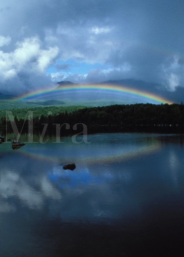 Rainbow and Clouds reflecting in Sandy Stream Pond, with the North Basins in the background,BSP, Maine.