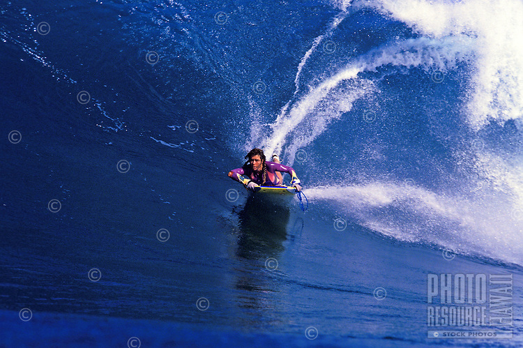 Phyliss Dameron bodyboarding the waves off Sunset Beach
