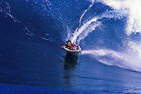 Phyliss Dameron bodyboarding the waves off Sunset Beach