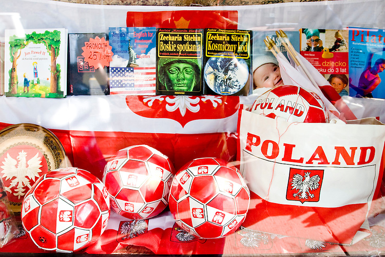 A storefront in Greenpoint, a Polish section of Brooklyn, shows off pride in the Polish national team on June 15, 2006. <br /> <br /> The World Cup, held every four years in different locales, is the world's pre-eminent sports tournament in the world's most popular sport, soccer (or football, as most of the world calls it).  Qualification for the World Cup is open to any country with a national team accredited by FIFA, world soccer's governing body. The first World Cup, organized by FIFA in response to the popularity of the first Olympic Games' soccer tournaments, was held in 1930 in Uruguay and was participated in by 13 nations.    <br /> <br /> As of 2010 there are 208 such teams.  The final field of the World Cup is narrowed down to 32 national teams in the three years preceding the tournament, with each region of the world allotted a specific number of spots.  <br /> <br /> The World Cup is the most widely regularly watched event in the world, with soccer teams being a source of national pride.  In most nations, the whole country is at a standstill when their team is playing in the tournament, everyone's eyes glued to their televisions or their ears to the radio, to see if their team will prevail.  While the United States in general is a conspicuous exception to the grip of World Cup fever there is one city that is a rather large exception to that rule.  In New York City, the most diverse city in a nation of immigrants, the melting pot that is America is on full display as fans of all nations gather in all possible venues to watch their teams and celebrate where they have come from.