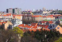 View to Prague 10 district with tree tops in the foreground from the Park Havlickovy Sady