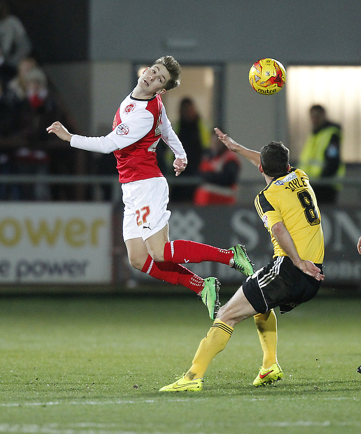 Fleetwood Town's Nick Haughton outhumps Sheffield United's Michael Doyle<br /> <br /> Photographer Mick Walker/CameraSport<br /> <br /> Football - The Football League Sky Bet League One - Fleetwood Town v Sheffield United - Saturday 13th December 2014 - Highbury Stadium - Fleetwood<br /> <br /> &copy; CameraSport - 43 Linden Ave. Countesthorpe. Leicester. England. LE8 5PG - Tel: +44 (0) 116 277 4147 - admin@camerasport.com - www.camerasport.com