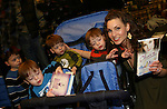 "All My Children's Alicia Minshew ""Kendall Hart Slater"" signs ""Kendall's"" new novel ""Charm"" for fans and poses with ""Spike"" - Benjamin, Caleb and Alex and their borther on February 20, 2008 at Barnes & Noble in Clifton, New Jersey. (Photo by Sue Coflin/Max Photos)"