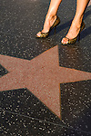 a woman pausing on Hollywood Blvd.'s walk of Fame
