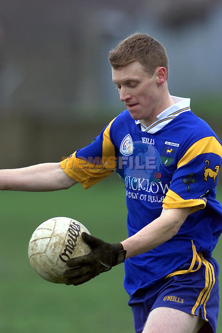 Wicklows Thomas Burke in action against Louth in Drogheda..Picture Fran Caffrey Newsfile.