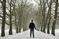Steve Rubenstein, of Doylestown, Pennsylvania, walks through the snow, Thursday, December 5, 2002 in Doylestown, Pennsylvania. The Philadelphia region was expecting 4-6 inches of snow from it's first major winter storm in two years. (Photo by William Thomas Cain/photodx.com)