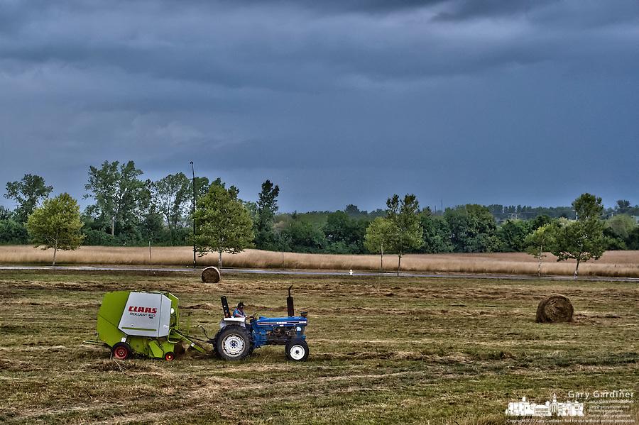 Late hay harvest on suburban farm.