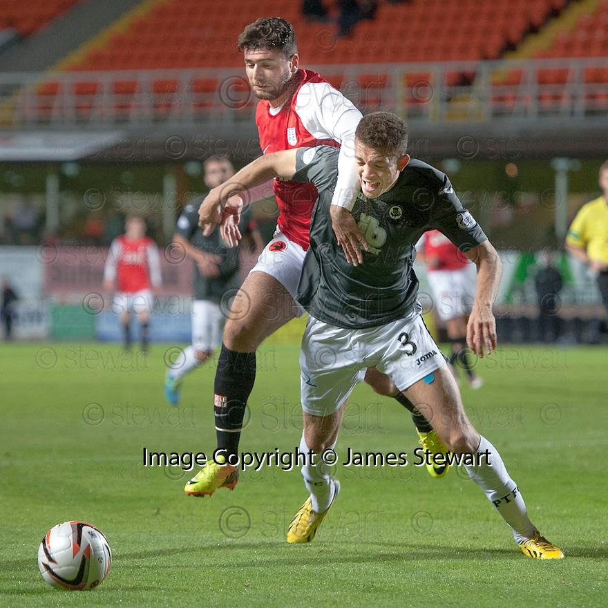 Dundee Utd's Nadir Ciftci pulls back Partick's Aaron Taylor-Sinclair.