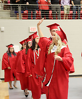 Farmington 2019 graduate Taighton Pettigrew waves to family members in the audience at the commencement ceremony last week at Cardinal Arena.