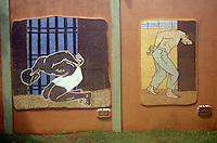 Murals in the notorious XXI jail showing the torture of prisoners during the Somoza regime, Leon, Nicaragua. This jail now houses tEl Museo de Tradiciones y Leyendas or Museum of Traditions and Legends.