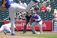Allan Dykstra #10 of the Las Vegas 51s takes a pickoff throw from the pitcher against the Omaha Storm Chasers at Werner Park on August 17, 2014 in Omaha, Nebraska. The Storm Chasers  won 4-0.   (Dennis Hubbard/Four Seam Images)