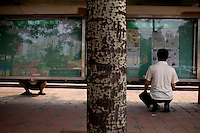 Beijingers read copies of the daily newspaper posted at a bus stop in Beijing, China on Wednesday, August 6, 2008. The city of Beijing is gearing up for the opening ceremonies of the Olympic Games.  Kevin German