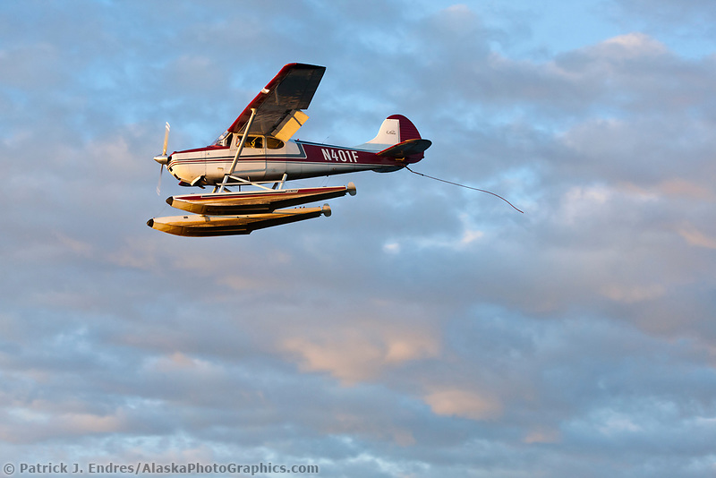 Bush plane approaches landing on floats along Lake Hood, Anchorage, Alaska.