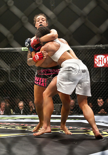 24.06.2011, Washinton, USA.   Germaine De Randamie wraps up Julia Budd during the STRIKEFORCE Challengers at the ShoWare Center in Kent, Washington. Budd won the fight in a unanimous decision.