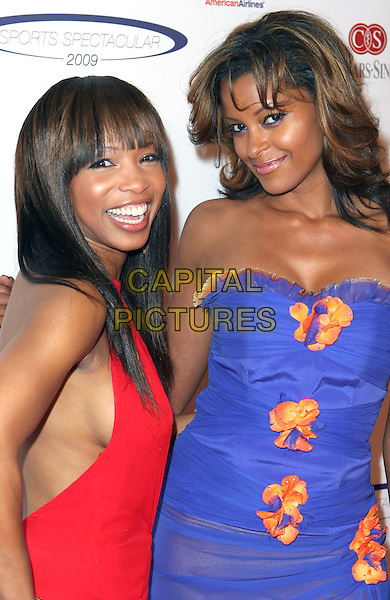 "ELISE NEAL & CLAUDIA JORDAN.Cedars Sinai Medical Center's ""24th ANNUAL SPORTS SPECTACULAR  at The Hyatt Regency Century Plaza, Century City, California, USA..June 7th, 2009.half length blue strapless dress orange flowers red.CAP/ADM/TC.©T. Conrad/AdMedia/Capital Pictures."