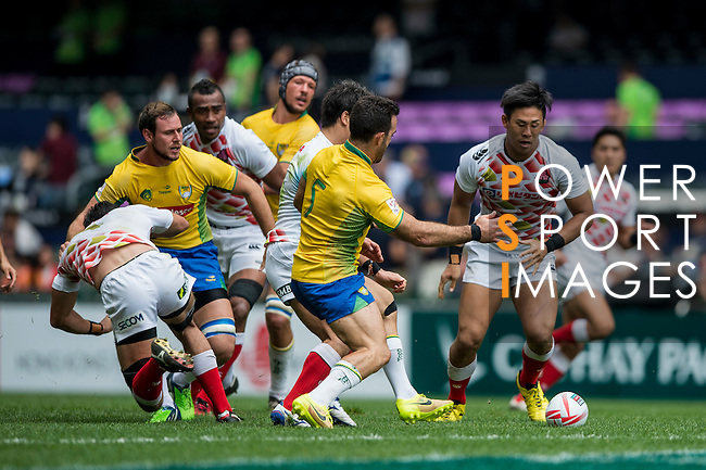 Japan (in white) vs Brazil (in yellow) during the HK Rugby Sevens 2016 on 08 April 2016 at Hong Kong Football Club in Hong Kong, China. Photo by Li Man Yuen / Power Sport Images