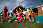 The two teams emerging from the dressing rooms at the Mersey Travel Arena, home to Marine Football Club (in white), pictured before they played host to Ilkeston FC in a Northern Premier League premier division match. The match was won by the home side by 3 goals to 1 and was watched by a crowd of 398. Marine are baed in Crosby, Merseyside and have played at Rossett Park (now the Mersey Travel Arena)  since 1903, the club having been formed in 1894.