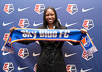#6 overall pick Maya Hayes of Sky Blue FC poses with her team's scarf during the NWSL draft at the Pennsylvania Convention Center in Philadelphia, PA, on January 17, 2014.