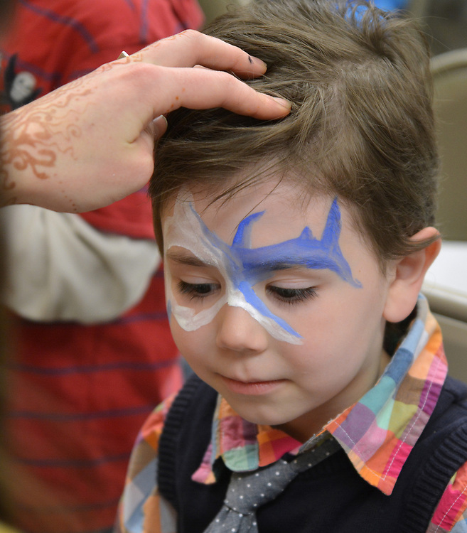 Boy getting his face painted by Shanti Payne at the Saugerties Democratic Committee Lasagna Dinner held at the Saugerties Senior Citizens. Center in Saugerties, NY, on Thursday, May 11, 2017.. Photo by Jim Peppler. Copyright Jim Peppler/2017.