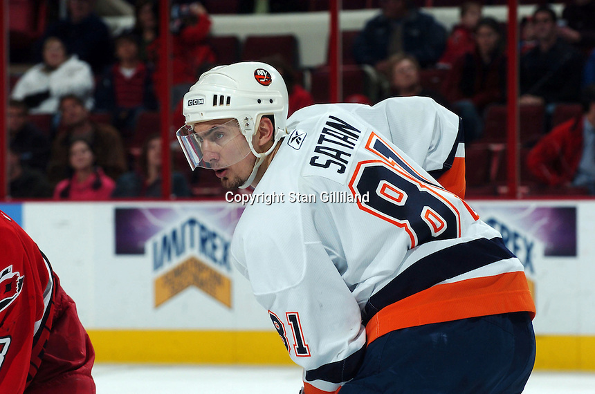 New York Islanders' Miroslav Satan of Slovakia concentrates prior to a faceoff with the Carolina Hurricanes during their game Thursday, Jan. 19, 2006 in Raleigh, NC. Carolina won 4-3.