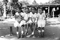 Group of young girls attending a friend's birthday party. Community of Nueva Esperanza, El Salvador, 1999.